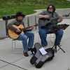 "Musicians ""Two Deep"" from Wells Fargo entertain riders as they pass"